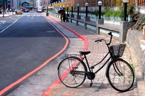 Black Bicycle on the Sidewalk
