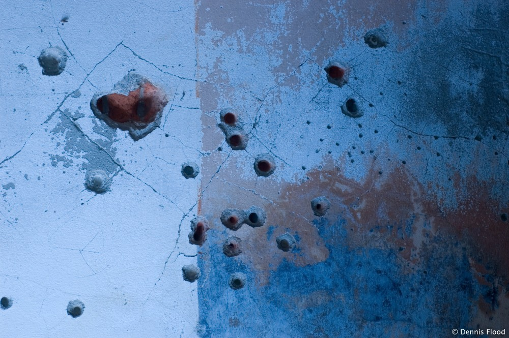 Bullet Holes in the Wall